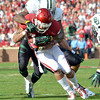 Oklahoma receiver Kenny Stills tries to shake off Baylor's Ahmed Dixon Saturday during the Sooners' game against the Bears at Owen Field. <br /> Kyle Phillips/The Transcript