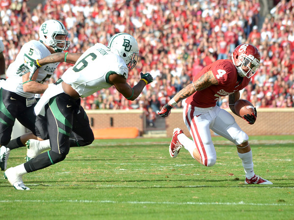 Oklahoma receiver Kenny Stills (4) tries to shake off Baylor's Ahmed Dixon (6)Saturday during the Sooners' game against the Bears at Owen Field.  .<br /> Kyle Phillips/The Transcript