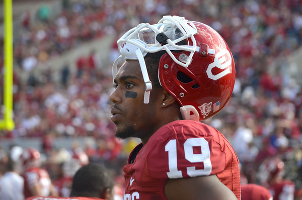 Oklahoma receiver Jalen Saunders (19) watches the OU defense play Saturday during the Sooners' game against the Bears at Owen Field.  .<br /> Kyle Phillips/The Transcript