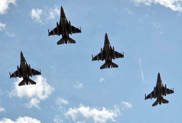 Military jets fly over Owen Field Saturday before Oklahoma's game against Baylor.<br /> Kyle Phillips/The Transcript