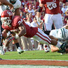 OU running back Brennan Clay dives for the goal line Saturday during the Sooners' game against the Bears at Owen Field.  Clay scored on the following play.<br /> Kyle Phillips/The Transcript