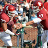 Oklahoma's Blake Bell (10) hands off the ball to Trey Millard (33) during the Sooners' game against the Bears at Owen Field.  <br /> Kyle Phillips/The Transcript