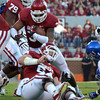 OU's Trey Millard (33) runs through a hole created by the Oklahoma defense during the Sooners' game against Kansas at Owen Field.<br /> Kyle Phillips/The Transcript