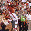 Oklahoma receiver Sterling Shepard (3) makes a leaping catch in the end zone Saturday during the Sooners' game against Kansas at Owen Field.<br /> Kyle Phillips/The Transcript
