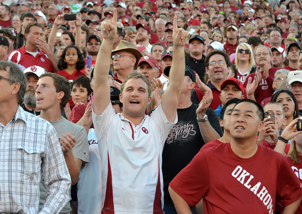 An Oklahoma fan celebrates after the Sooners score their first touchdown during their game against Kansas at Owen Field.<br /> Kyle Phillips/The Transcript