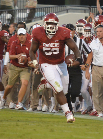 OU's Caseu Walker (53) runs with the ball after picking up a fumble Saturday during the Sooners' game against the Jayhawks Saturday at Owen Field.<br /> Kyle Phillips/The Transcript