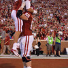 OU quarterback Blake Bell (10) celebrates with Bronson Irwin (68) after Bell scores a touchdown in the second quarter of the Sooners' game against Kansas at Owwen Field.<br /> Kyle Phillips/The Transcript