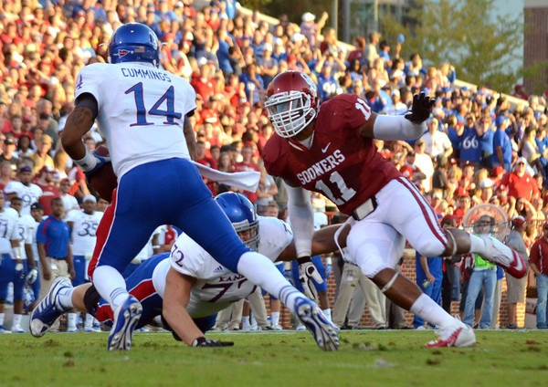 OU defender R.J. Washington chases down Kansas quarterback Michael Cummings (14) as he tries to run with the ball during the Sooners' game against the Jay Hawks at Owen Field.<br /> Kyle Phillips/The Transcript