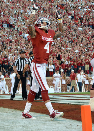 OU receiver Kenny Stills celebrates after scoring a touchdown Saturday during the Sooners' game against Kansas at Owen Field. Kyle Phillips/The Transcript