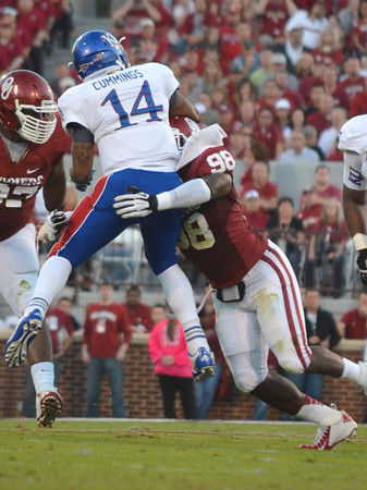 OU's Chuka Ndulue (98) picks up Kansas quarterback Michael Cummings (14) as he runs with the ball Saturday during the Sooners' game against the Jayhawks at Owen Field.<br /> Kyle Phillips/The Transcript