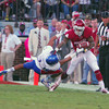 Oklahoma receiver Kenny Stills (4) pushes away Kansas Tyler Patmon (33) as Stills runs with the ball after making a catch during the Sonners' game the Jay Hawks at Owen Field.<br /> Kyle Phillips/The Transcript