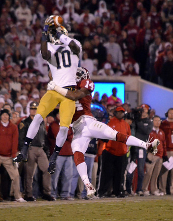 Notre Dame receiver DaVaris Daniels makes a leaping catch ovet the head of OU's Aaron Colvin (14) Saturday during the Sooners' game against the Fighting Irish at Owen Field.<br /> Kyle Phillips/The Transcript