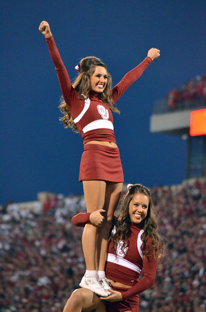 Oklahoma cheerleaders pump up the crowd before the start of the Sooners' game against Notre Dame Saturday at Owen Field.<br /> Kyle Phillips/The Transcript
