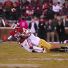OU receiver Jalen Saunders (18) loses the ball after he is hit on a pass play during the Sooners' game against Notre Dame.  The play resulted in an interception for the Fighting Irish.<br /> Kyle Phillips/The Transcript