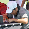 OU golfer  Abraham Ancer signs his scorecard Thursday afternoon after he finishes his round of golf during the NCAA Regional Golf Tournament at the  Jimmie Austin OU Golf Club.<br /> Kyle Phillips/The Transcript