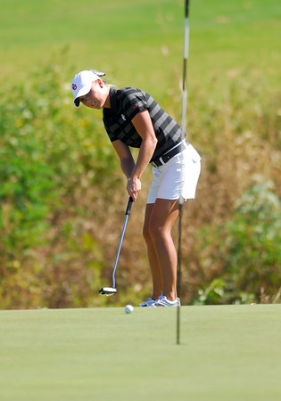 OU golfer Taylor Schmidt putts the ball on the 18th green Wednesday afternoon during the Susie Maxwell Berning Classic at the Jimmie Austin Golf Course.<br /> Kyle Phillips/The Transcript