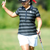 OU golfer Chirapat Jao-Javanil waves to the crowd after putting her ball into the hole on the 18th green Wednesday during the Susie Maxwell Berning Classic at the Jimme Austin OU Golf Club.<br /> Kyle Phillips/The Transcript