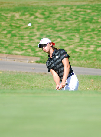 OU golfer Kaitilyn Rohrback chips the ball onto the green on the 18th hole Wednesday afternoon during the Susie Maxwell Berning Classic at the Jimmie Austin Golf Course.<br /> Kyle Phillips/The Transcript
