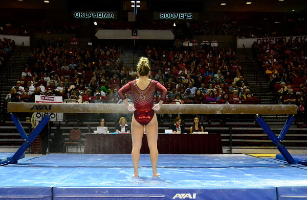 OU's Erika Brewer prepares for her routine on the balance beam during her her routine at the Sooners' gymnastics meet against LSU at Lloyd Noble Center Sunday, Feb. 9, 2014.<br /> Kyle Phillips / The Transcript