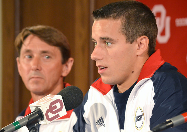 OU Men's Gymnastics Head Coach Mark William, left, looks on as Olympic gymnist Jake Dalton talks about what it was like during the Olympic Trails Thursday afternoon at a press conference at the University of Oklahoma.<br /> Kyle Phillips/The Transcript