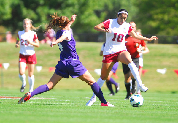 Oklahoma forward Renae Cuellar (10) gets the ball around TCU's Bobbi Clemmer (4) Sunday during the Sooners' game at John Crain Field.<br /> Kyle Phillips/The Transcript