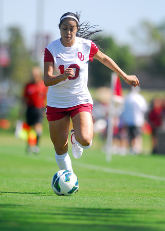 Oklahoma forward Renae Cuellar controls the ball as she runs down the field Sunday during the Sooners' game against TCU at John Crain Field.<br /> Kyle Phillips/The Transcript