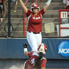 Oklahoma's Lauren Chamberlain (44) slies home with Oklahoma's first run of the game, Monday, June 3, 2012, in the first game of the Womens College World Series championship against Alabama at ASA Hall of Fame Stadium in Oklahoma City. Jerry Laizure/The Transcript