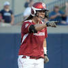 Oklahoma pitcher Keilani Ricketts celebrates her hit against Alabama, Monday, June 3, 2012, in the first game of the Womens College World Series championship at ASA Hall of Fame Stadium in Oklahoma City. Jerry Laizure/The Transcript