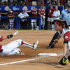 Oklahoma outfielder Briana Turang (2) slides safely into third as Alabama third baseman Courtney Conley waits on the ball, Monday, June 3, 2012, in the first game of the Womens College World Series championship at ASA Hall of Fame Stadium in Oklahoma City. Jerry Laizure/The Transcript