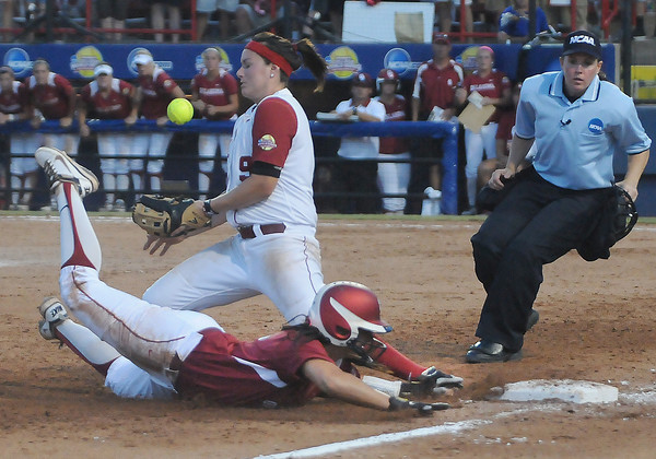 Oklahoma's Lauren Chamberlain (44) slides into third as Alabama's third baseman Courtney Conley bobbles the ball, Monday, June 3, 2012, in the first game of the Womens College World Series championship against Alabama at ASA Hall of Fame Stadium in Oklahoma City. Jerry Laizure/The Transcript