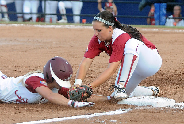 Oklahoma third baseman Javen Henson tags Alabama Jazlyn Lunceford out at third, Monday, June 3, 2012, in the first game of the Womens College World Series championship at ASA Hall of Fame Stadium in Oklahoma City. Jerry Laizure/The Transcript