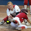 Oklahoma reliever Michelle Gascoigne puts the tag on Alabama unner Jennifer Fenton, Tuesday, June 5, 2012, in the second game of the Womens College World Series championship at ASA Hall of Fame Stadium in Oklahoma City. Fenton was out on the play. Jerry Laizure / The Transcript