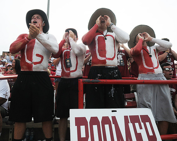 Sooner fans (from left) Beau Proctor, Luke Jones, D.J. Gasso and Brice Turang cheer a Keilani Ricketts strike out of an Alabama batter, Tuesday, June 5, 2012, in the second game of the Womens College World Series championship at ASA Hall of Fame Stadium in Oklahoma City. Jerry Laizure / The Transcript