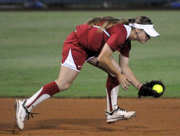 Oklahoma shortstop Jessica Vest scoops up an Alabama ground ball Wednesday, June 6, 2012, in the third game of the Womens College World Series championship at ASA Hall of Fame Stadium in Oklahoma City. Jerry Laizure / The Transcript
