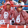 Ken and Wendy Vest, parents of Sooner infielder Jessica Vest, wait for the rain to stop, Wednesday, June 6, 2012, at the third game of the Womens College World Series championship at ASA Hall of Fame Stadium in Oklahoma City. Jerry Laizure / The Transcript