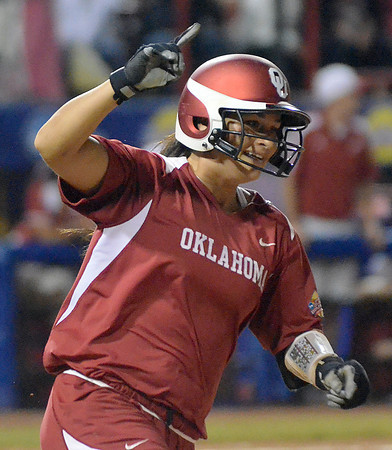 Oklahoma first baseman Lauren Chamberlain celebrates her homerun against Alabama, Wednesday, June 6, 2012, in the third game of the Womens College World Series championship at ASA Hall of Fame Stadium in Oklahoma City. Jerry Laizure / The Transcript