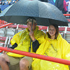 Die hard softball fans Kyle and cChloe White of Edmond, wait out the rain delay, Wednesday, June 6, 2012, in the third game of the Womens College World Series championship at ASA Hall of Fame Stadium in Oklahoma City. Jerry Laizure / The Transcript