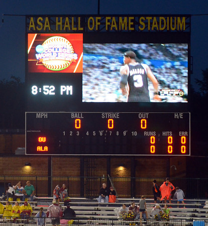 The Thunder-Spurs basketball playoff game was shown on the stadium scoreboard during the rain delay Wednesday, June 6, 2012, at the third game of the Womens College World Series championship at ASA Hall of Fame Stadium in Oklahoma City. Jerry Laizure / The Transcript