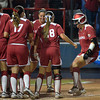 Oklahoma's Lauren Chamberlain is greeted at home plate by her teammates aftter she homered against Alabama, Wednesday, June 6, 2012, in the third game of the Womens College World Series championship at ASA Hall of Fame Stadium in Oklahoma City. Jerry Laizure / The Transcript