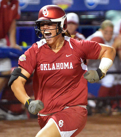 Oklahoma pitcher Keilani Ricketts celebrates her homerun against Alabama, Wednesday, June 6, 2012, in the third game of the Womens College World Series championship at ASA Hall of Fame Stadium in Oklahoma City. Jerry Laizure / The Transcript