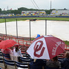 Die hard fans wait in the rain, Wednesday, June 6, 2012, for the start of the third game of the Womens College World Series championship at ASA Hall of Fame Stadium in Oklahoma City. Jerry Laizure / The Transcript