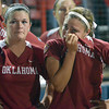 Oklahoma players Ali Vandever (left) and Destinee Martinez react after losing to Alabama in the WCWS championship series.