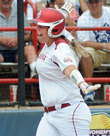 Oklahoma designated player Katie Norris scores on her home run against Arizona State, Sunday, June 3, 2012, in a semifinal game of the Womens College World Series at ASA Hall of Fame Stadium in Oklahoma City. Jerry Laizure/The Transcript