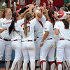 Oklahoma players mob designated player Katie Norris after her home run against Arizona State, Sunday, June 3, 2012, in a semifinal game of the Womens College World Series at ASA Hall of Fame Stadium in Oklahoma City. Jerry Laizure/The Transcript