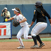 Oklahoma shortstop Jessica Vest tosses the ball to third to get the force out on Arizona State's Amber Freeman, Sunday, June 3, 2012, in a semifinal game of the Womens College World Series at ASA Hall of Fame Stadium in Oklahoma City. Jerry Laizure/The Transcript