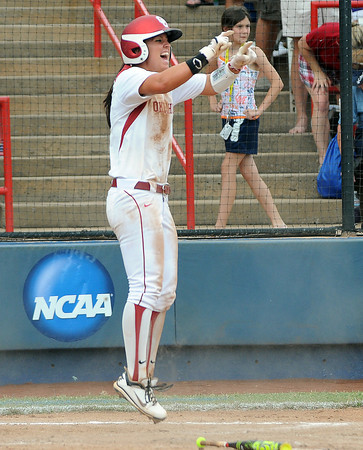Oklahoma third baseman Javen Henson celebrates after scoring on Arizona State, Sunday, June 3, 2012, in a semifinal game of the Womens College World Series at ASA Hall of Fame Stadium in Oklahoma City. Jerry Laizure/The Transcript