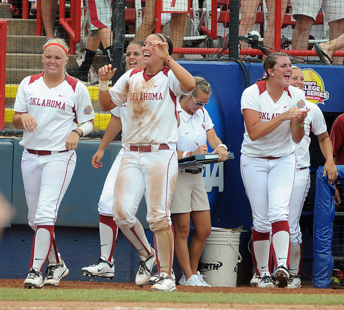 Oklahoma players celebrate Jessica Shults' 2-rbi double against Arizona State, Sunday, June 3, 2012, in a semifinal game of the Womens College World Series at ASA Hall of Fame Stadium in Oklahoma City. Jerry Laizure/The Transcript