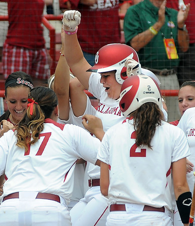 Oklahoma designated player Katie Norris celebrates with her teammates after her home run against Arizona State, Sunday, June 3, 2012, in a semifinal game of the Womens College World Series at ASA Hall of Fame Stadium in Oklahoma City. Jerry Laizure/The Transcript