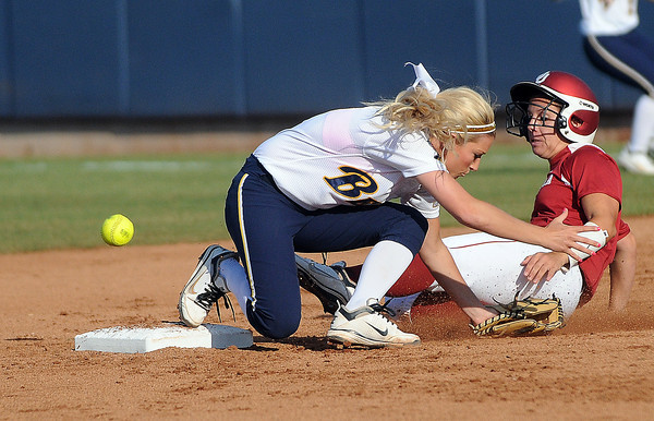 Oklahma pinch runner Callie Parsons is sae at second as the ball gets past Cal second baseman Jace Williams, Friday, June 1, 2012, in a second round game of the Womens College World Series at ASA Hall of Fame Stadium in Oklahoma City. Jerry Laizure/The Transcript