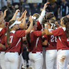 Oklahoma players celebrate their 3-0 win over California, Friday, June 1, 2012, in a second round game of the Womens College World Series at ASA Hall of Fame Stadium in Oklahoma City. Jerry Laizure/The Transcript